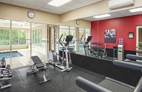 Fitness center with an elliptical and a weight station