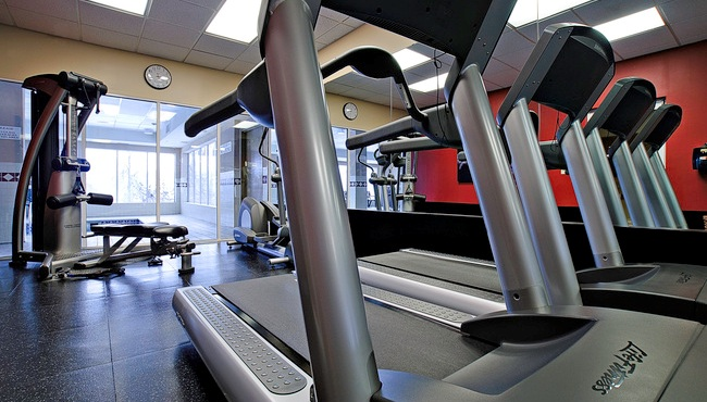 Fitness center with treadmills and weight station