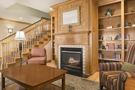 Welcoming lobby with a fireplace by the stairs
