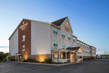 Exterior of the Country Inn & Suites, Elyria, OH lit up at dusk