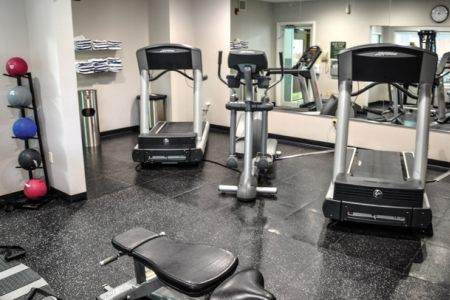 Fitness center with two treadmills, an elliptical and several medicine balls