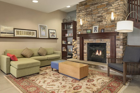 Comfortable hotel lobby with fireplace