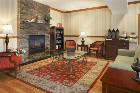 Lobby fireplace and coffee station at the Country Inn & Suites, Macedonia