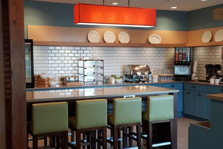 Breakfast room featuring blue cabinets and green chairs