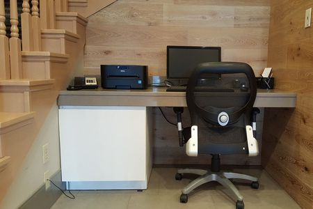 Business center with computer, printer and work chair