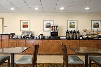 Dining area with coffee and juice on the breakfast bar