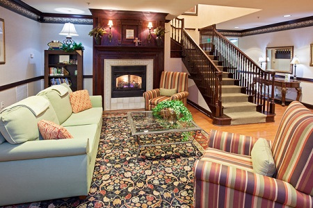 Hotel lobby with a fireplace by the staircase
