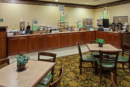 Dining Area With Coffee And Cereal Dispensers On The Breakfast Bar Youngstown Hotel