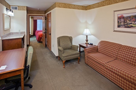 Youngstown hotel suite with a desk and a sleeper sofa