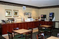Dining room with coffee station and microwave on the bar