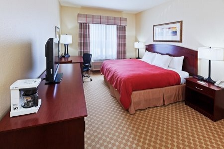 Hotel room in Tulsa with king bed and flat-screen TV