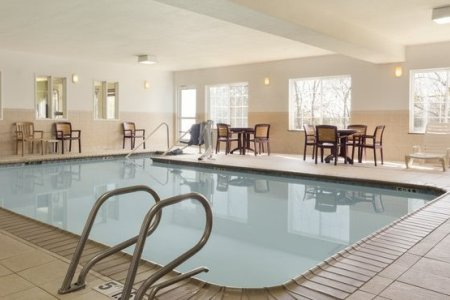 Indoor pool with sitting area in Norman