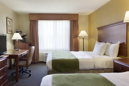 Hotel room with two queen beds and work desk in Norman