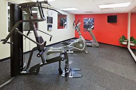 Oklahoma City hotel's fitness center with treadmill and more