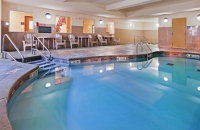 Oklahoma City hotel's indoor pool with poolside seating