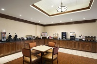 Dining area with juices and coffee, waffle makers and more