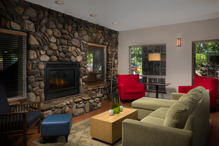 Lobby with fireplace, couch and stone accent wall