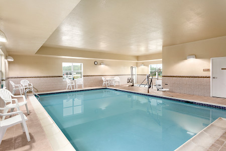 Indoor pool, hot tub and seating area
