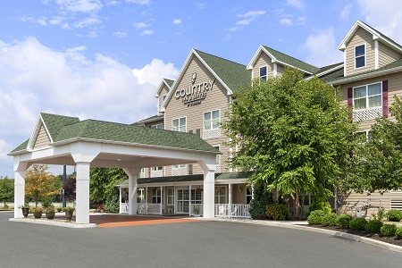 Exterior of the Country Inn & Suites, Carlisle, PA with a large carport
