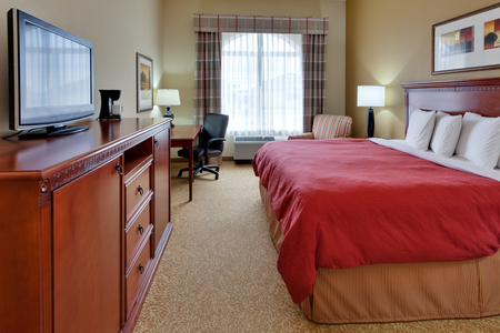 Harrisburg, PA hotel room includes king bed and flat-screen TV