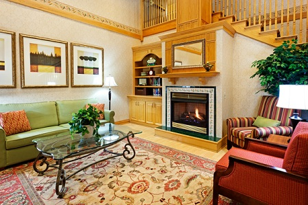 Welcoming lobby with fireplace and seating