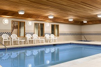 Well-lit indoor pool area at Lehighton hotel