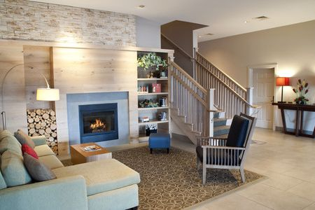 Welcoming lobby with a modern fireplace and cozy furnishings