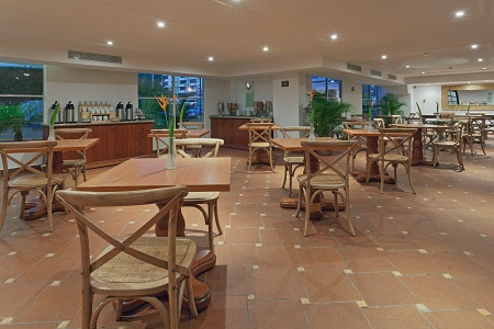 Hotel dining area with a coffee bar and wooden furniture