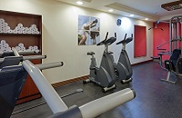 Fitness center with exercise equipment and fresh towels