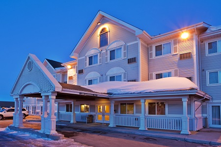 Snow-covered exterior of the Country Inn & Suites in Saskatoon, SK