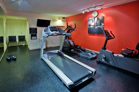 Fitness centre with treadmill and free weights