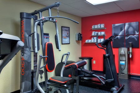 Fitness center with weight machine and elliptical