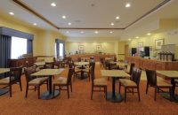 Hotel breakfast area with tables and chairs