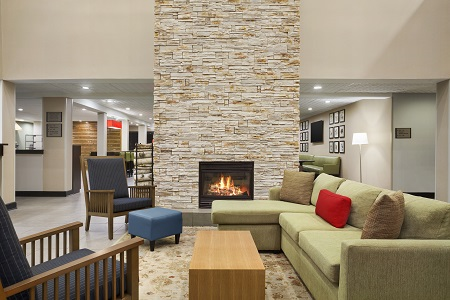 Hotel lobby with fireplace and sofa