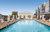 Outdoor pool area with white lounge chairs