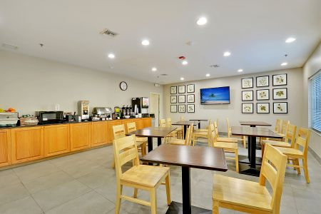 Breakfast room featuring table seating and hot meal options