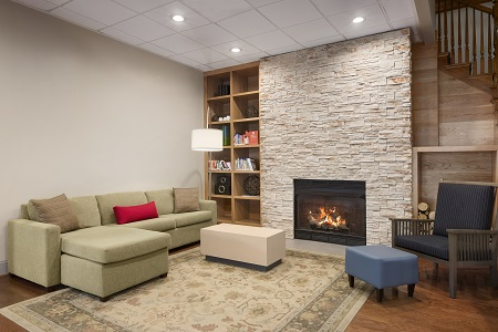 Hotel lobby with fireplace and sofa with accent pillows