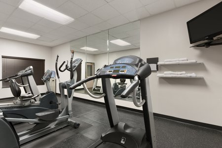 Fitness center's treadmill and wall-mounted TV