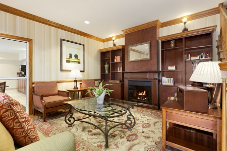 Sumter hotel's inviting lobby with fireplace and seating
