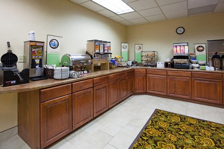 Breakfast area featuring wafflemakers, juice dispenser and more