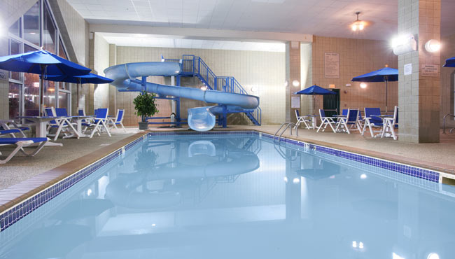 Rapid City hotel pool area features a waterslide