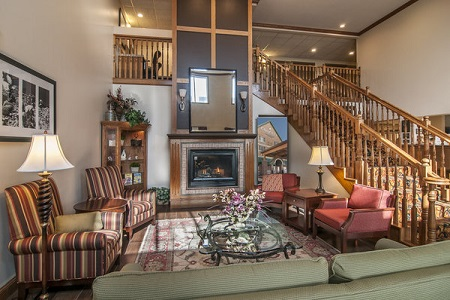Lobby in Rapid City with a fireplace and a library