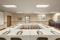 Meeting room with tables arranged in square