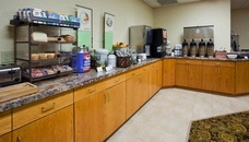 Breakfast counter with coffee station and assorted breads