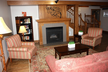 Regina hotel lobby with fireplace and lending library