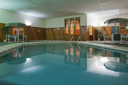 Indoor pool with tables and chairs in Sparta