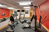 Fitness center with treadmill and TV