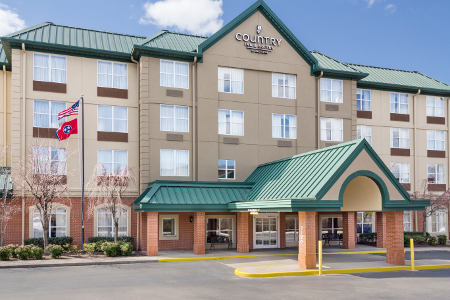 Exterior of the Country Inn & Suites on sunny day
