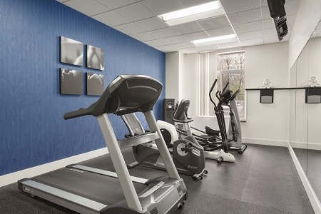 Fitness center with treadmill and other workout equipment