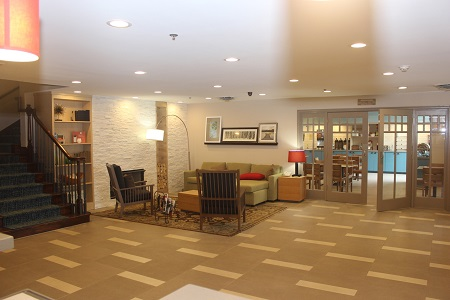 Hotel lobby with seating area and stairs